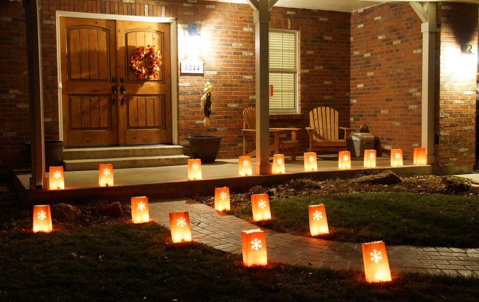 luminarias lined up in front of house